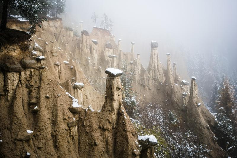 Perca Earth Pyramids under the mist stock images