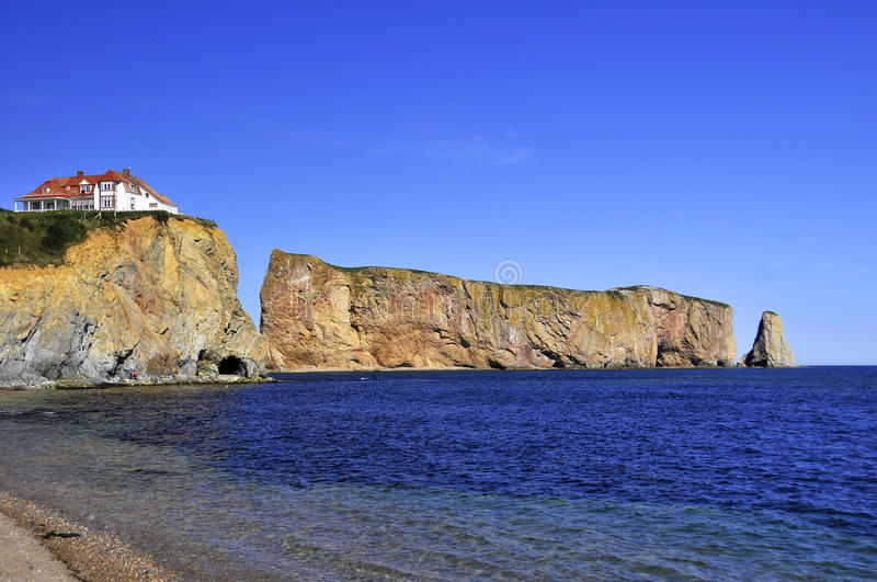 Perce Rock. (French rocher Perce, pierced rock) is a huge sheer rock formation in the Gulf of Saint Lawrence on the tip of the Gaspe Peninsula in Quebec, Canada stock image