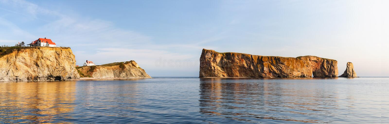 Perce Rock at Gaspe Peninsula. Perce Rock or Rocher Perc� view with reflections at Gaspe Peninsula coast in Quebec, Canada stock image
