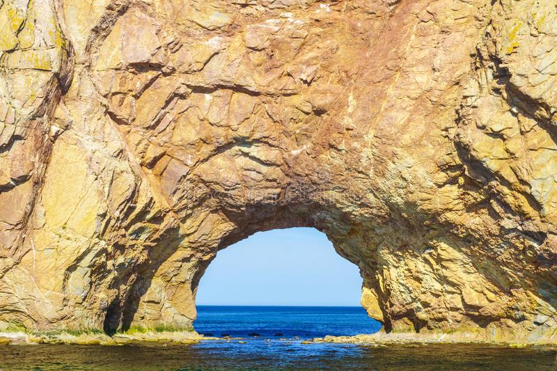 Perce rock, at the tip of Gaspe Peninsula. View of arch in the Perce rock, at the tip of Gaspe Peninsula, Quebec, Canada royalty free stock photo