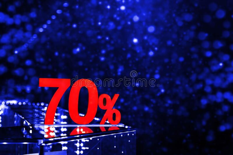 70 percent discount with blue bokeh background. Discounts in the shopping center. Seasonal sale, black friday. Red label stock photos