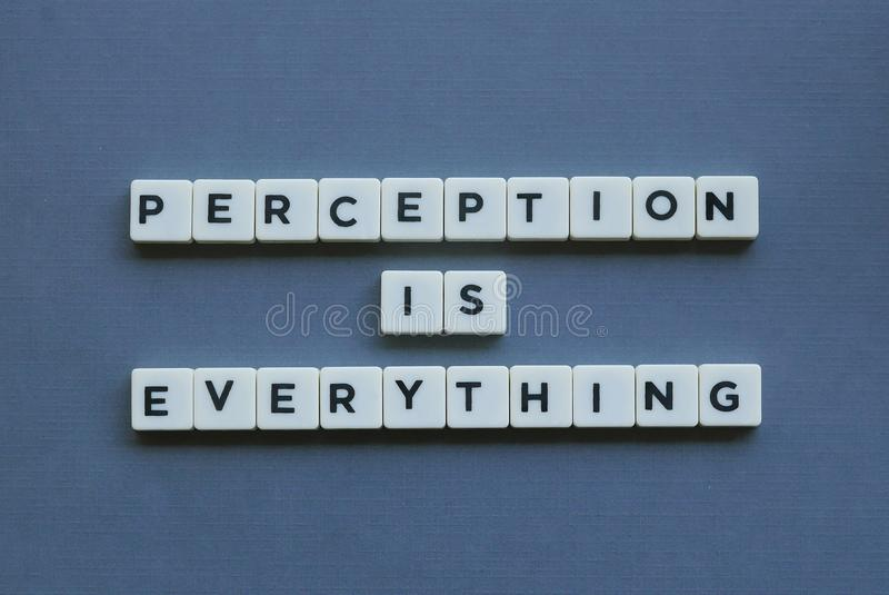 ' Perception Is Everything ' word made of square letter word on grey background. Understanding, recognition, insight, concept, conscious, recognize royalty free stock images