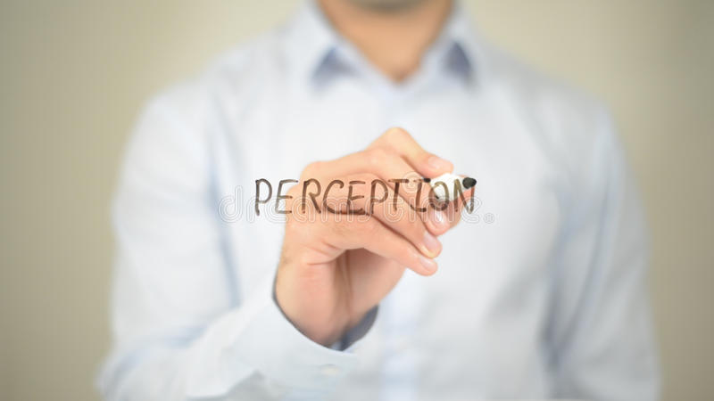 Perception , Man writing on transparent screen. High quality royalty free stock photos