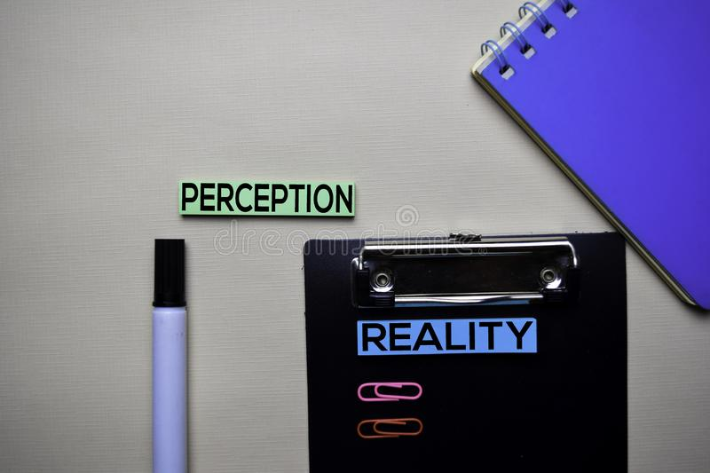 Perception or Reality text on sticky notes with office desk concept royalty free stock image