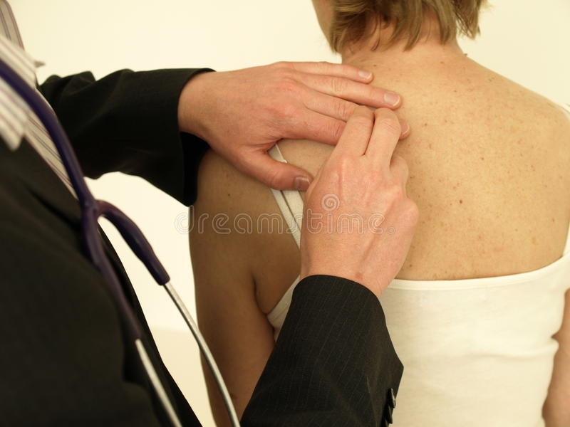 Percussion. Doctor with stethoscope examining woman's chest - percussion royalty free stock photography