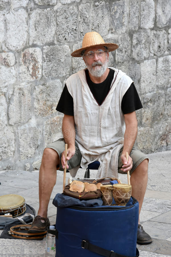 Percussionist. Member of a group, percussionist, of musicians making medieval music with old instruments at the city wall in Dubrovnik, Croatia