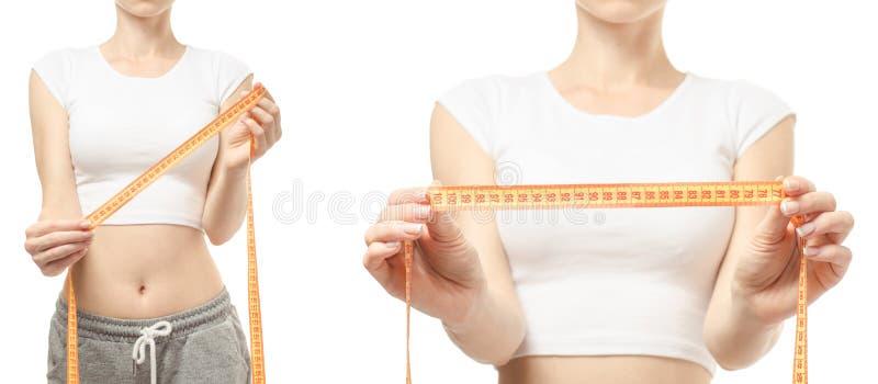 Perda de peso da perda de peso da jovem mulher com um teste padrão ajustado do centímetro fotografia de stock