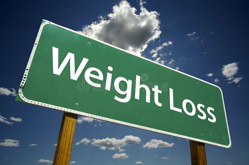 Perda de peso - sinal de estrada fotografia de stock