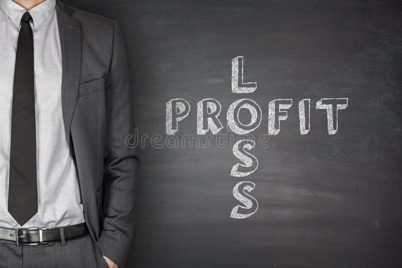 Perda & lucro no quadro-negro fotografia de stock royalty free