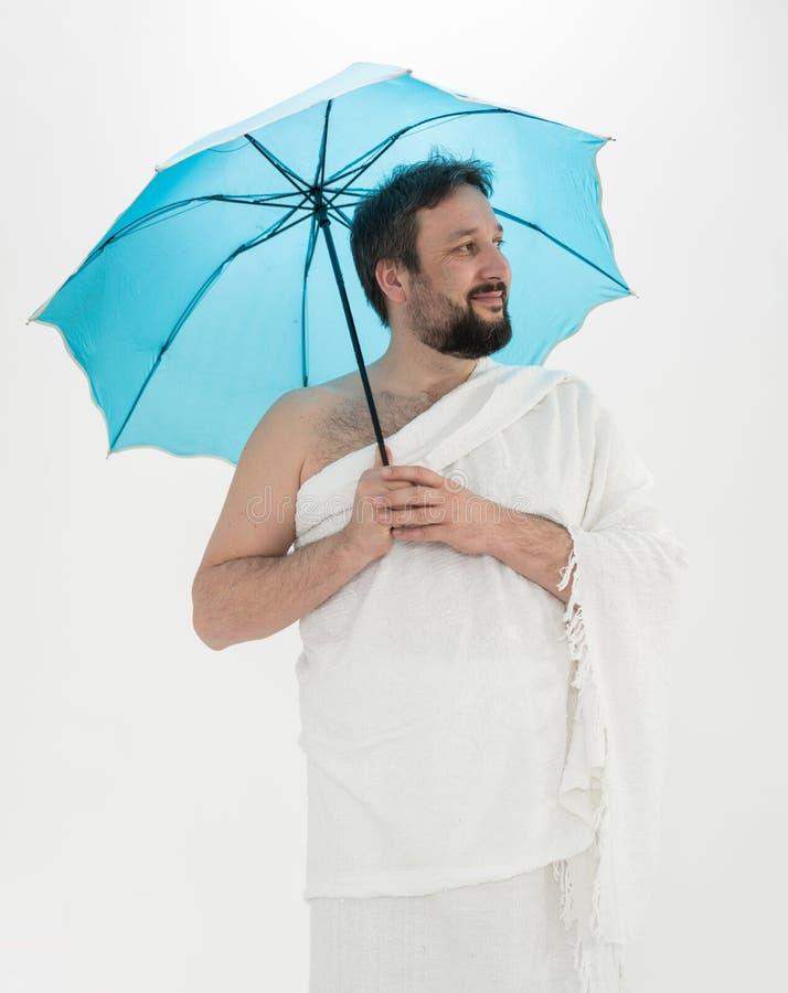 Peregrino do Haj com guarda-chuva fotos de stock royalty free