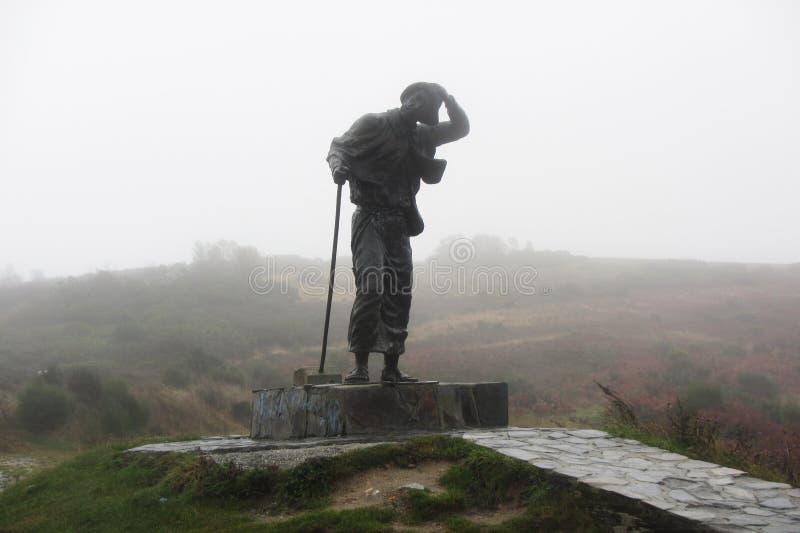 Peregrino en la lluvia fotografía de archivo libre de regalías