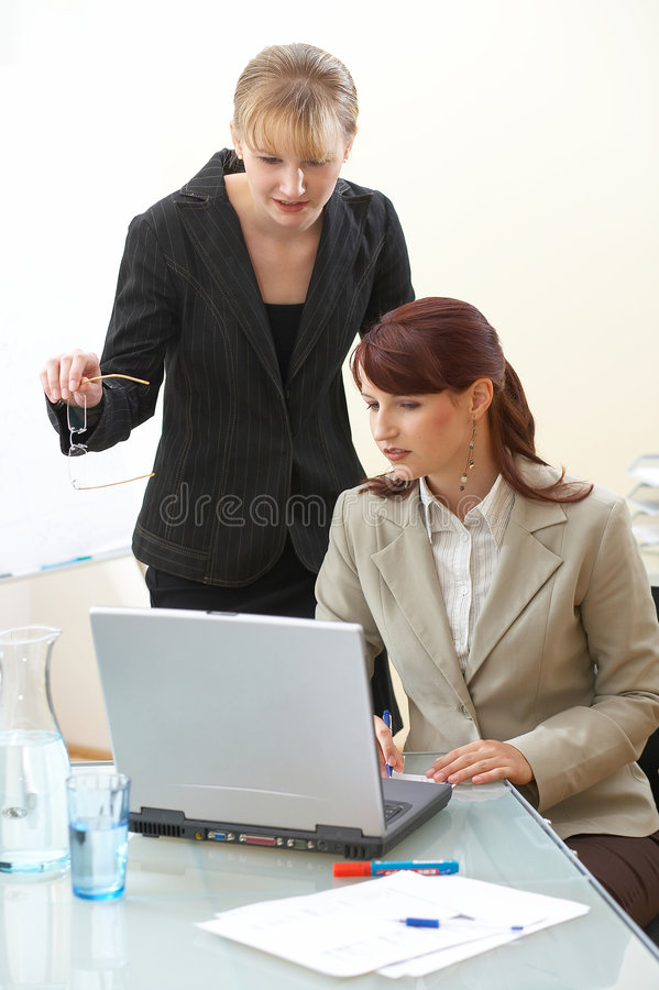 Perfect!!. Two businesswoman are discussing the work royalty free stock photos