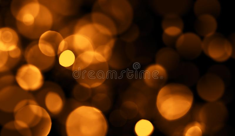 Perfect abstract gold bokeh for background. Glitters light stock photo