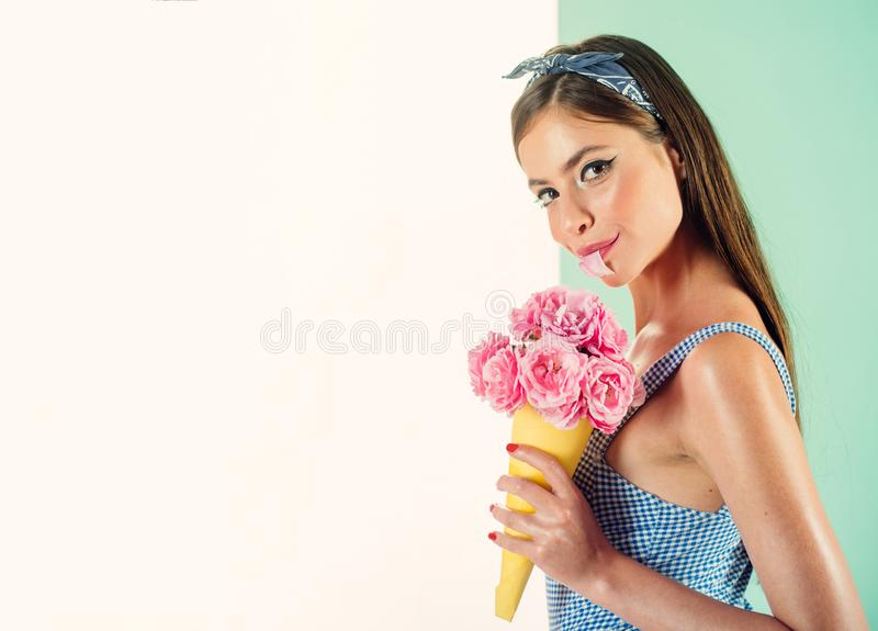 Perfect as a flower. flower bouquet. Florist. Summer. pinup girl with fashion hair. retro woman eating ice cream from. Flowers. pin up woman with trendy makeup royalty free stock photos