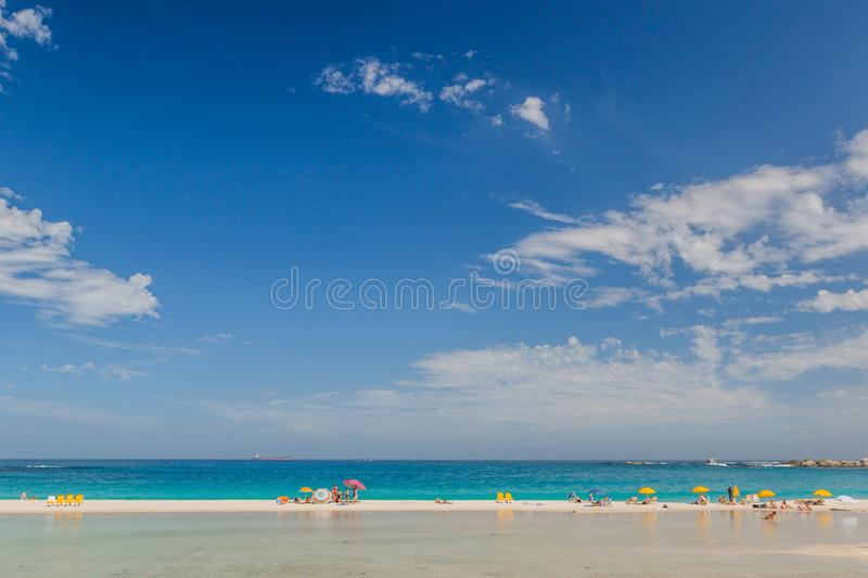 Perfect Beach Day on Camps Bay Beach, South Africa with Big Blue Sky stock photos