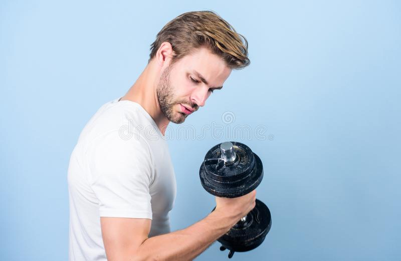 Perfect biceps. sportsman training in gym. Sport dumbbell equipment. Athletic fitness man. Weight lifting. man workout. With barbell. power and energy. Strong royalty free stock photo