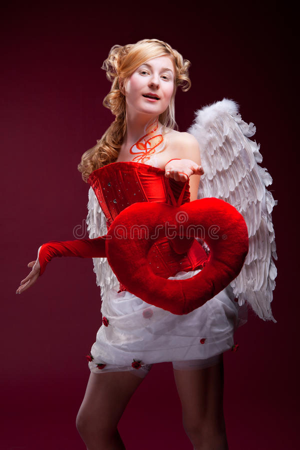 Download Perfect Blonde Angel With A Red Heart Stock Image - Image: 18461303