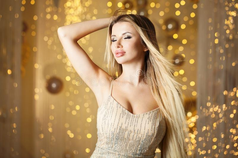 Perfect blonde woman on abstract gold bokeh glitter background royalty free stock image