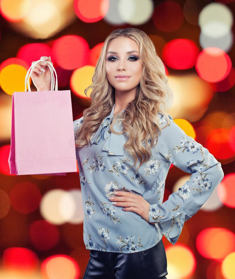 Perfect blonde woman with shopping bag royalty free stock photo