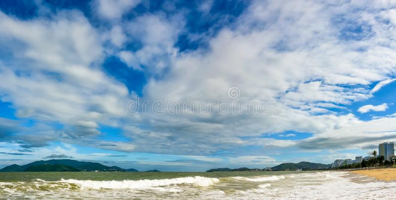 blue sky over wide sandy tropical beach stock images