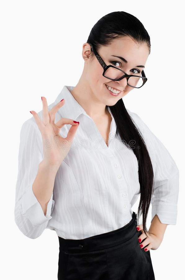Perfect - business woman showing OK hand sign smiling happy. White background. Studio shot royalty free stock photos