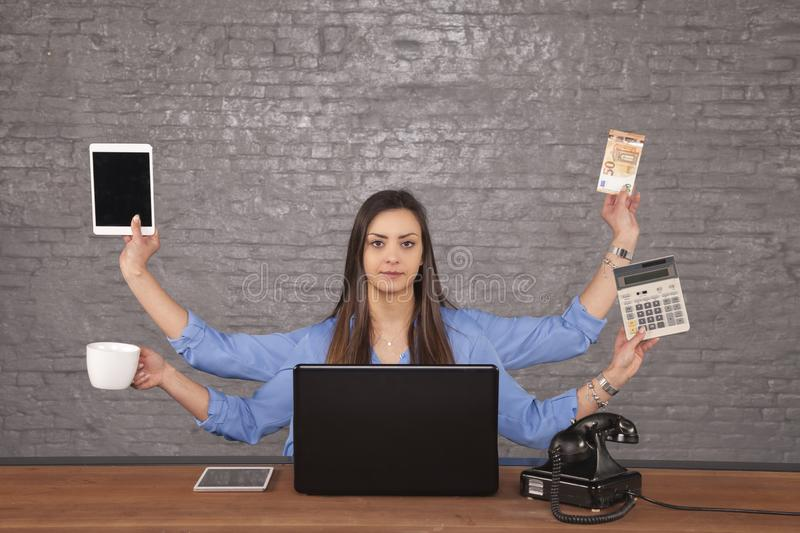 Perfect businesswoman, doing several things at once stock images