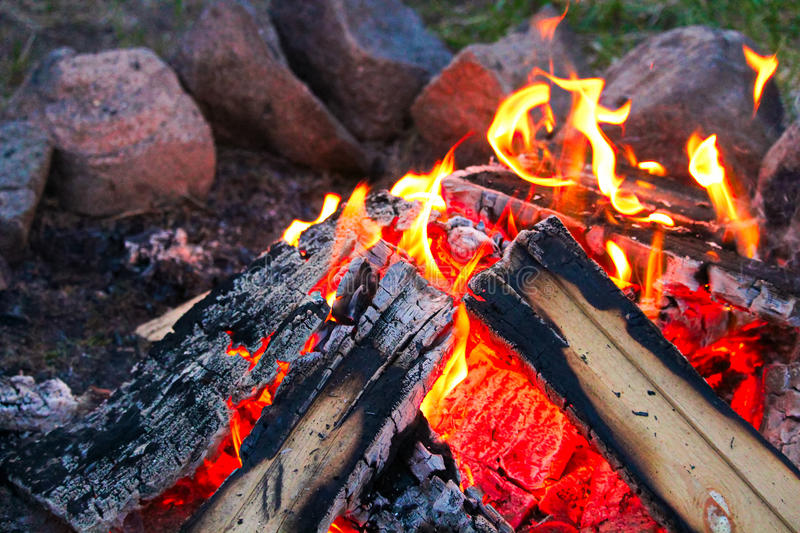 The perfect campfire with a ring of stones around it stock photo