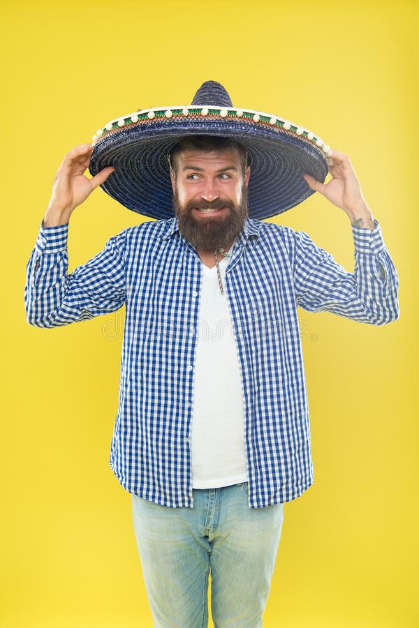 Perfect for cinco de mayo celebration. Bearded man in mexican hat. Hipster in wide brim. Traditional fashion accessory. For costume party. Hes in love with stock photos