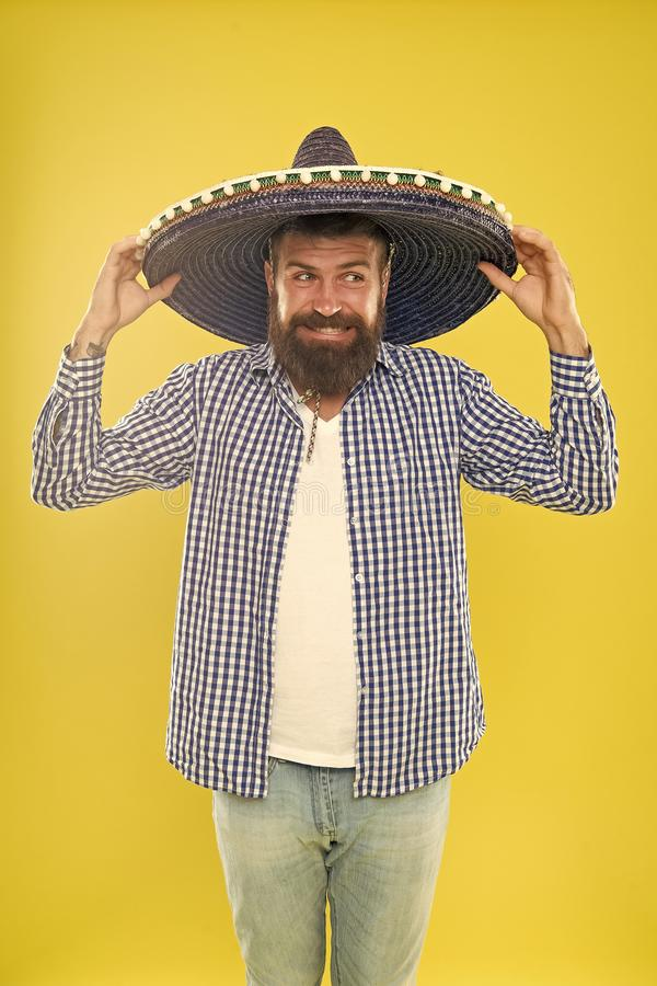 Perfect for cinco de mayo celebration. Bearded man in mexican hat. Hipster in wide brim. Traditional fashion accessory. For costume party. Hes in love with stock images