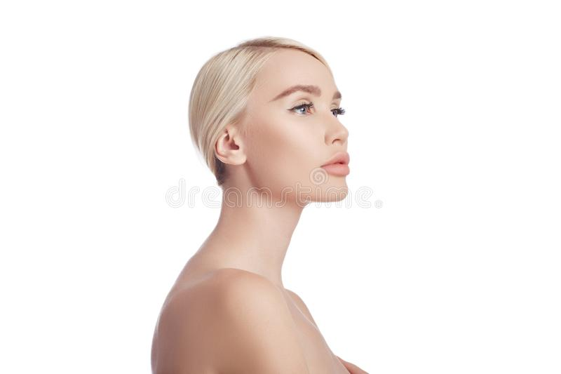 Perfect clean skin of a woman, a cosmetic for wrinkles. Rejuvenating effect on the skin care. Clean pores no wrinkles. Girl blonde royalty free stock image
