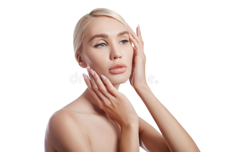 Perfect clean skin of a woman, a cosmetic for wrinkles. Rejuvenating effect on the skin care. Clean pores no wrinkles. Girl blonde royalty free stock photos