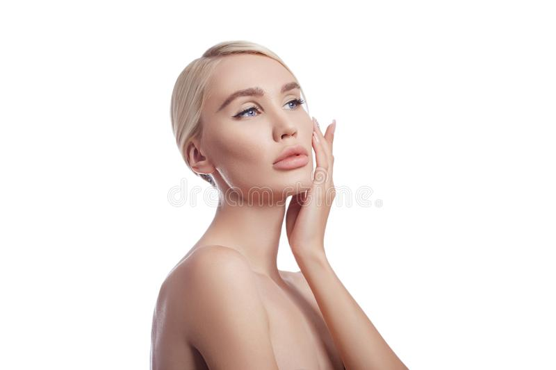 Perfect clean skin of a woman, a cosmetic for wrinkles. Rejuvenating effect on the skin care. Clean pores no wrinkles. Girl blonde royalty free stock photo