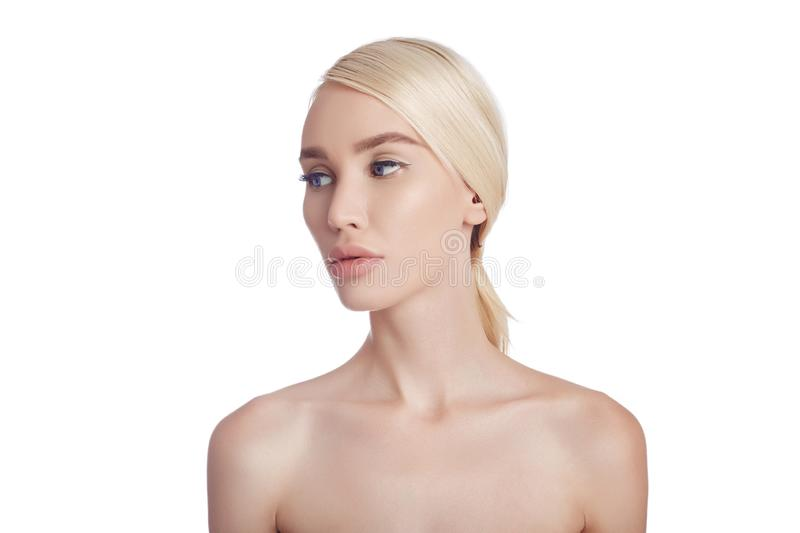 Perfect clean skin of a woman, a cosmetic for wrinkles. Rejuvenating effect on the skin care. Clean pores no wrinkles. Girl blonde stock photo