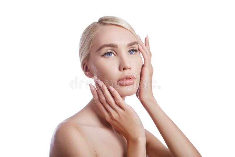 Perfect clean skin of a woman, a cosmetic for wrinkles. Rejuvenating effect on the skin care. Clean pores no wrinkles. Girl blonde stock photography