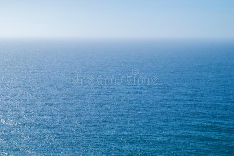 Perfect clear blue sky and water of Atlantic Ocean. royalty free stock photos