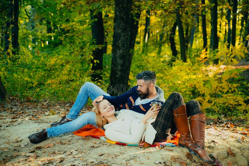 This is perfect cofe. Family picnic. Valentines day. couple in love relax in autumn forest. Camping and hiking. Happy stock photography