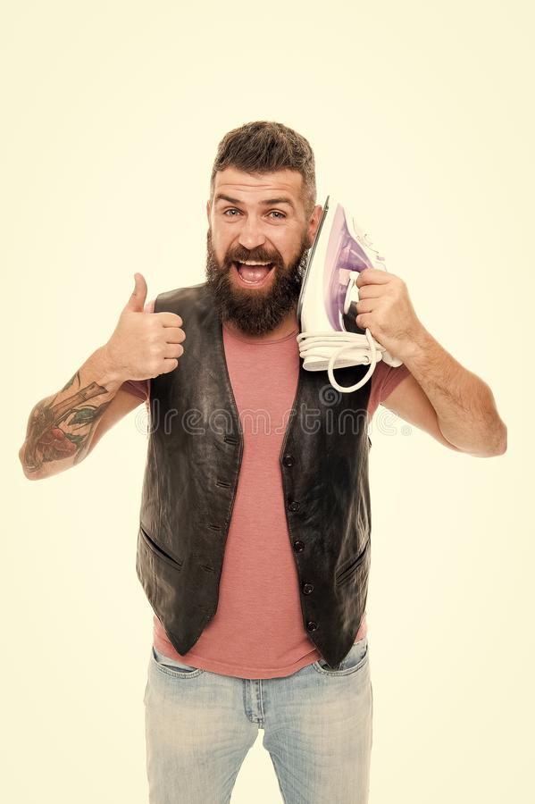 Perfect connection. Man bearded hipster hold electric ironing tool. How to iron clothes correctly. . Guy with iron on. White background isolated. Tailor and dry royalty free stock photo