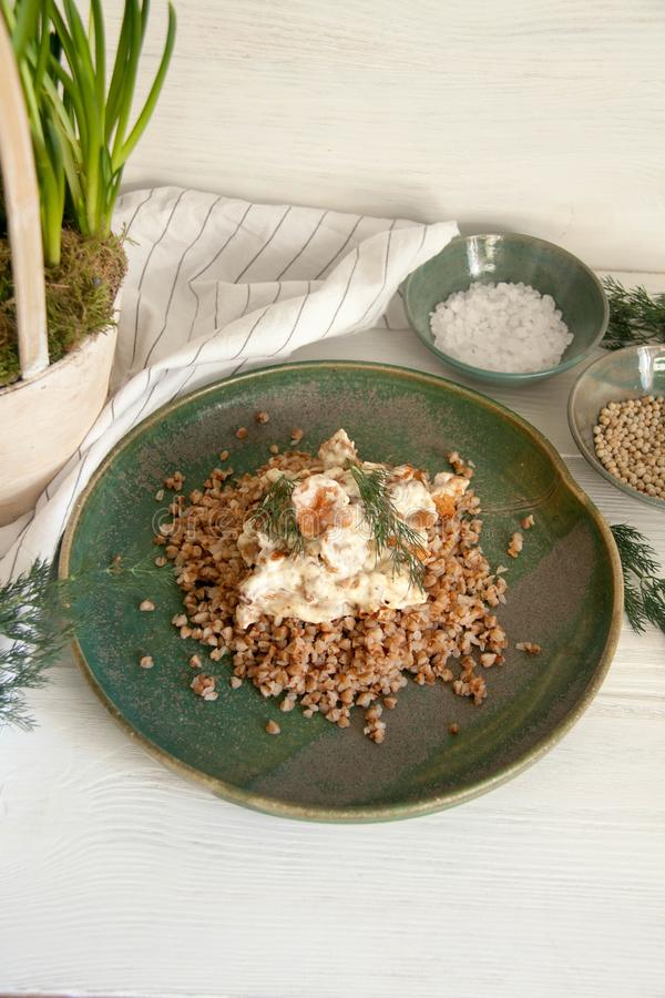 Buckwheat with mushrooms in sour cream sauce. Perfect cozy and delicious dinner: Buckwheat with mushrooms in sour cream sauce stock photography