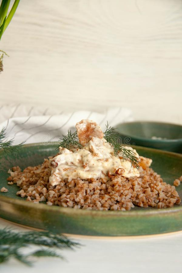 Buckwheat with mushrooms in sour cream sauce. Perfect cozy and delicious dinner: Buckwheat with mushrooms in sour cream sauce royalty free stock photo