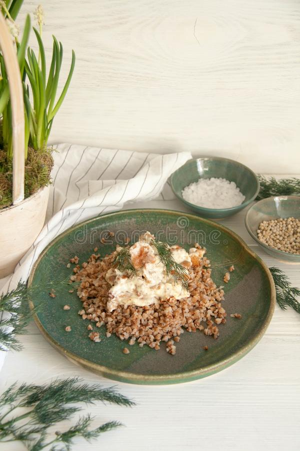 Buckwheat with mushrooms in sour cream sauce. Perfect cozy and delicious dinner: Buckwheat with mushrooms in sour cream sauce stock image