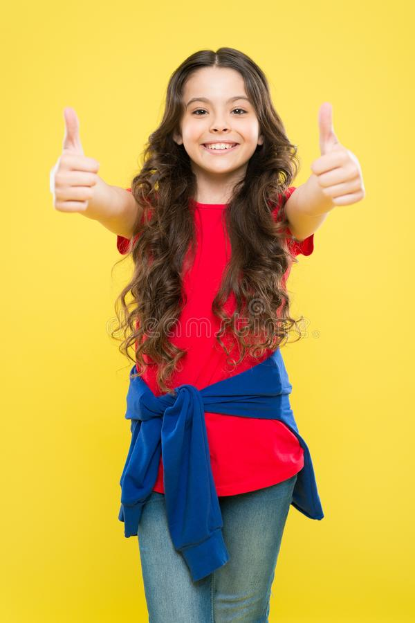 Perfect curls. Kid cute face with adorable curly hairstyle. Little girl grow long hair. Teen fashion model. Styling stock photos