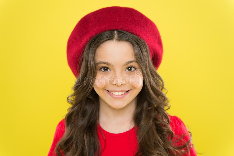 Perfect curls. Kid cute face with adorable curly hairstyle wear beret hat. Little fashionista. Little girl grow long stock images