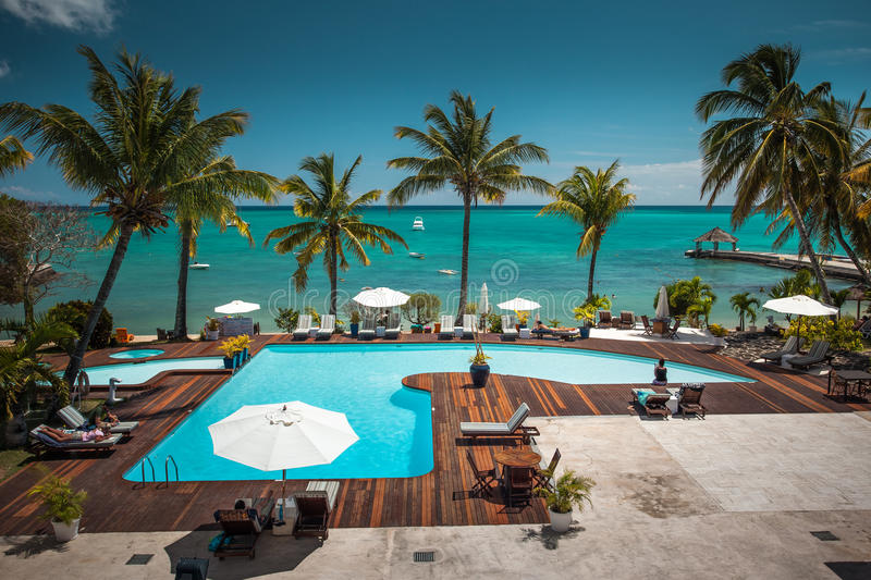 Tropical Hotel Mauritius. Nice outdoor swimming pool with an amazing ocean view. Mauritius stock photo