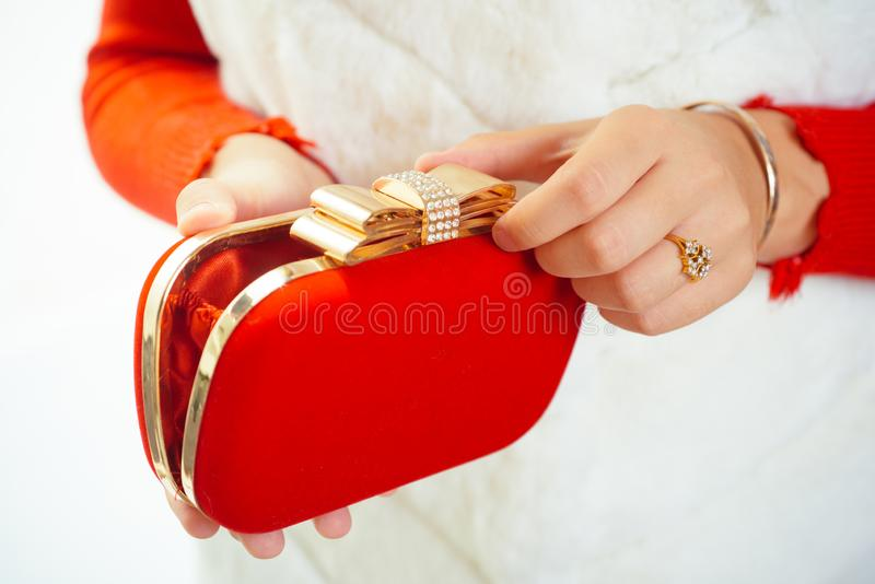 Perfect for the evening. Clutch bag in female hands. Mini bag. Fashion handbag. Fashion accessory. Vintage or retro. Clutch design. Classic purse or pouch. Red stock photos