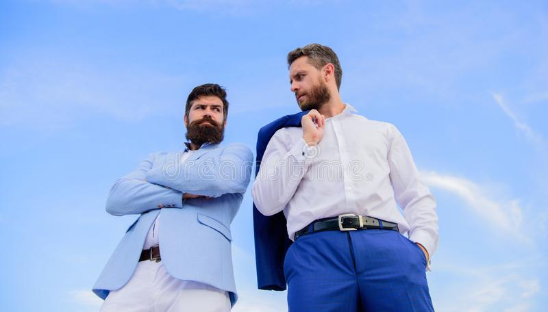 Perfect in every detail. Business men stand back to back blue sky background. Impeccable appearance improves reputation. Professional entrepreneur. Bearded stock photography