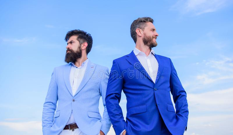 Perfect in every detail. Business men stand blue sky background. Business people concept. Well groomed appearance. Improves business reputation entrepreneur royalty free stock photos