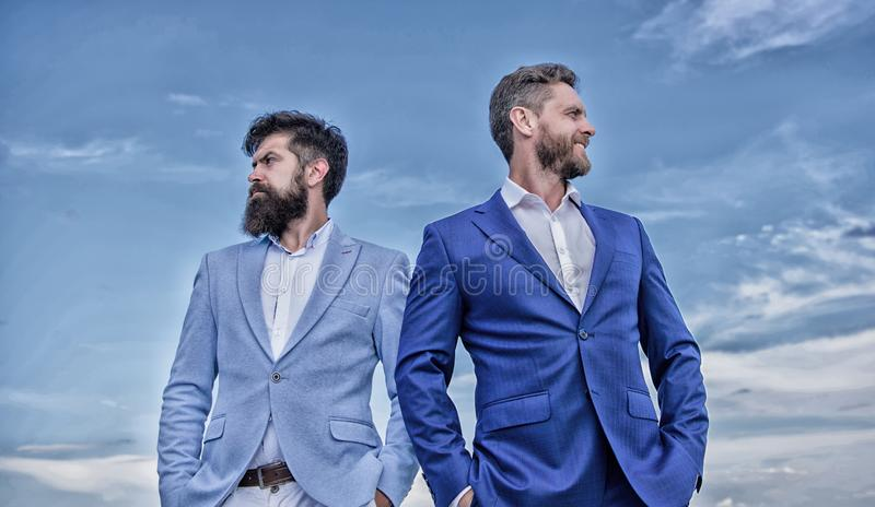Perfect in every detail. Business men stand blue sky background. Business people concept. Well groomed appearance. Improves business reputation entrepreneur royalty free stock photo