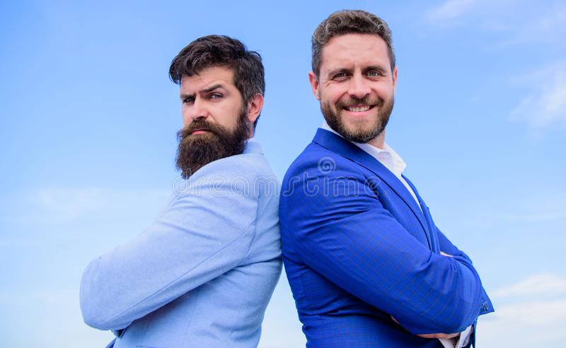 Perfect in every detail. Business men stand blue sky background. Well groomed appearance improves business reputation. Entrepreneur. Business people concept stock image