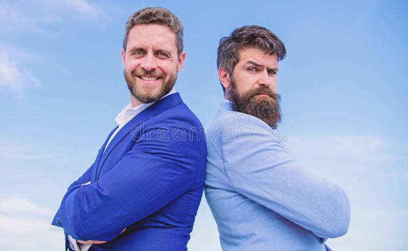 Perfect in every detail. Business men stand blue sky background. Well groomed appearance improves business reputation. Entrepreneur. Business people concept stock images