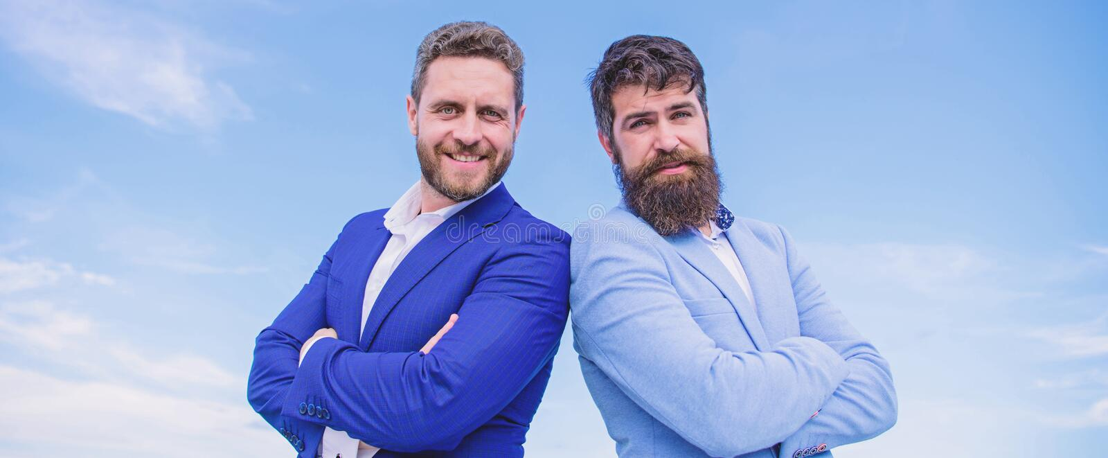 Perfect in every detail. Business people concept. Bearded business people posing confidently. Business men stand blue. Sky background. Well groomed appearance stock images